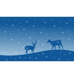 Silhouette of deer with snowfall Christmas scenery vector