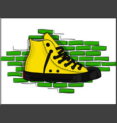 Yellow sneakers on a background of a jelly brick vector