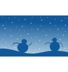 Snowman christmas scenery of silhouettes vector