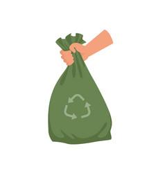 hand holding green plastic trash bag garbage vector image