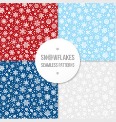 set of seamless patterns with white snowflakes vector image