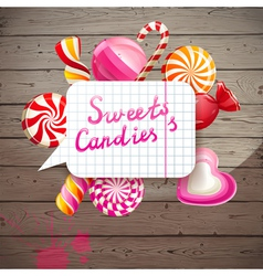 wooden background with candies vector image