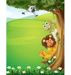 A tree at the top of the hills with animals hiding vector image vector image