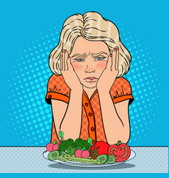 Pop art unhappy girl with plate of vegetables vector