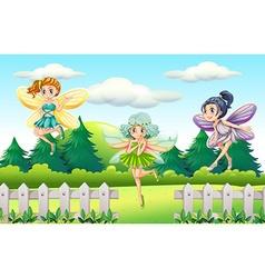 Three fairies flying in garden vector