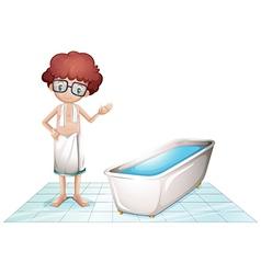 A boy with a towel beside a bathtub vector image