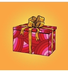 Red festive box tied with a gold ribbon vector