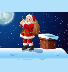 santa cartoon stands on the roof with a large bag vector image