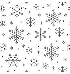 Seamless pattern with black snowflakes on white vector