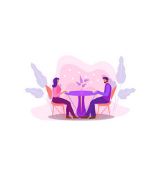 A guy and a girl are sitting at a table in a cafe vector
