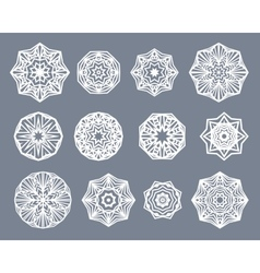 Mandalas set White snowflakes isolated on gray vector image