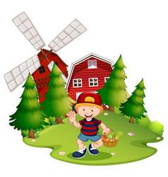 Farm boy with windmill vector