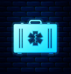 glowing neon first aid kit and medical symbol vector image