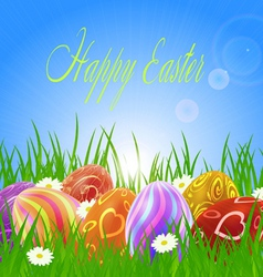 easter eggs on green grass vector image vector image