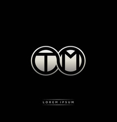 Tm initial letter linked circle capital monogram vector