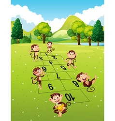Monkeys playing hopscotch in park vector image