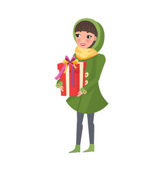 woman in green winter coat with big present gift vector image