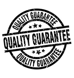 Quality guarantee round grunge black stamp vector