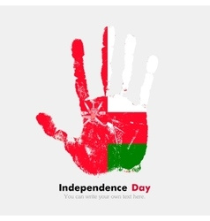 Handprint with the Flag of Oman in grunge style vector image