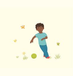 African american boy preparing to kick ball vector