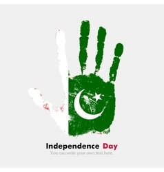 Handprint with the flag of pakistan in grunge vector