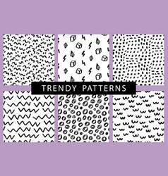 Trendy hand drawn minimal seamless patterns set vector