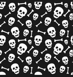 Halloween seamless pattern with skull and bone vector