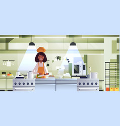 female professional chef cook chopping vegetables vector image