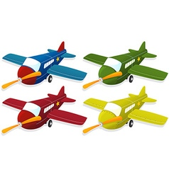 Airplane in four different colors vector image vector image