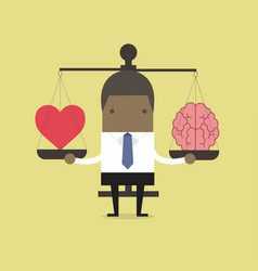 african businessman with heart and brain on scales vector image