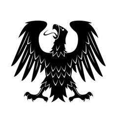 Heraldic eagle with raised wings turned head vector