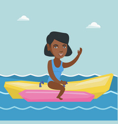 Young african-american woman riding a banana boat vector