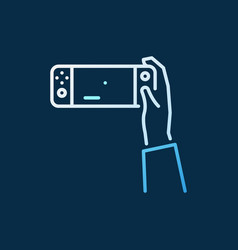 hand holding handheld console colored vector image