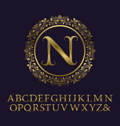 tendrils gold letters with n initial monogram vector image