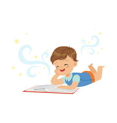 Funny little boy lying and reading magic book with vector