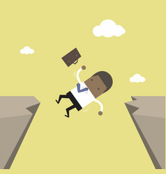 African businessman falling from gap of cliff vector