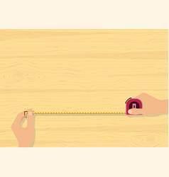 hands tape measuring on wood background vector image