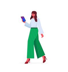 Businesswoman leader in formal wear using tablet vector
