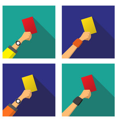 Hand with a red and yellow card of football vector