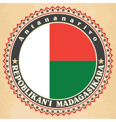 Vintage label cards of Madagascar flag vector image