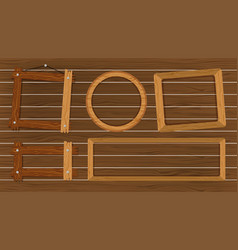 different shapes of frames on wooden wall vector image
