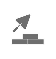 bricks with building trowel brickwork grey icon vector image