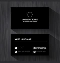 black paper business namecard on a black wood vector image