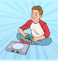 Pop art boy playing video game kid with console vector
