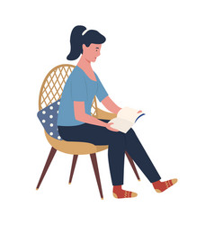 Woman reading hardcover book sitting on chair vector