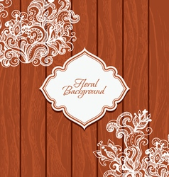 Wooden background with flowers and frame vector image