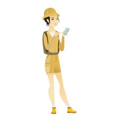 Asian traveler holding a mobile phone vector