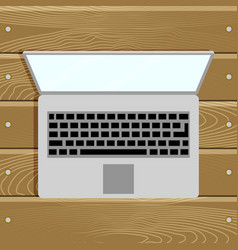 top view laptop computer on wood table vector image