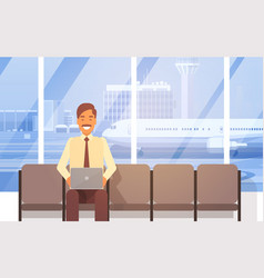 Man sitting in airport hall using laptop computer vector
