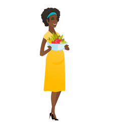 Young pregnant woman with bowl of fruits vector